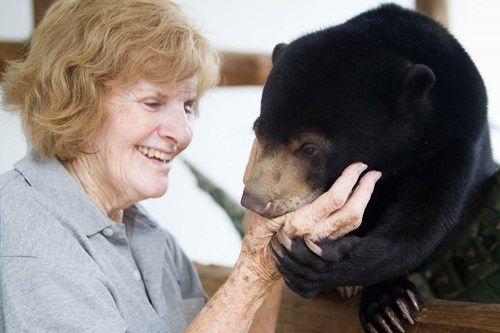 Mary Hutton and Maggie, a rescued sun bear cub